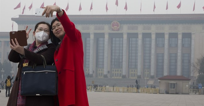 China says slowing economy won't stop anti-pollution efforts