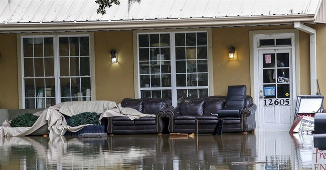 The Latest: Louisiana, Mississippi see rising waters