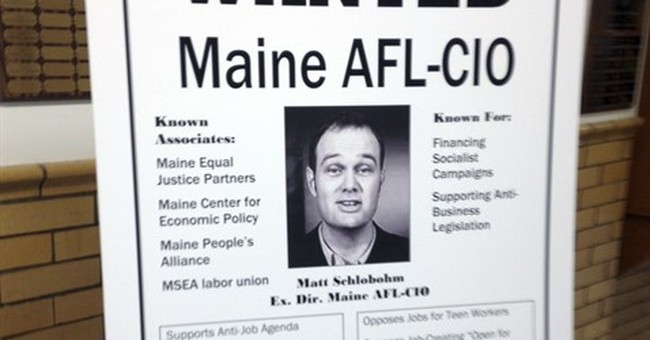 Maine governor displays wanted posters at latest town hall