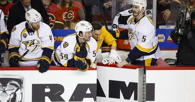 Linesman hit by Wideman is out for season with concussion