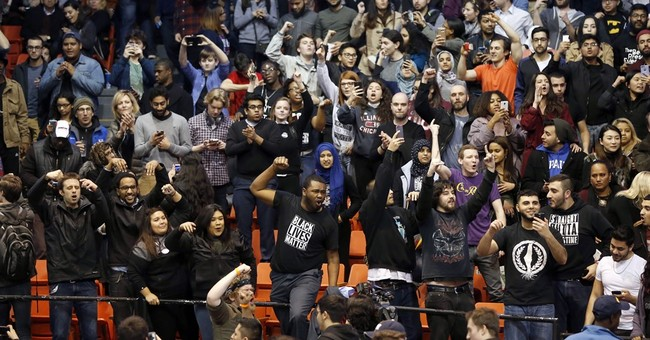 Protesters cheer when Trump rally canceled, jeer supporters
