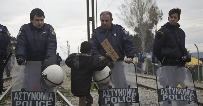 The Latest: Syrian refugee plays the piano at Greek border