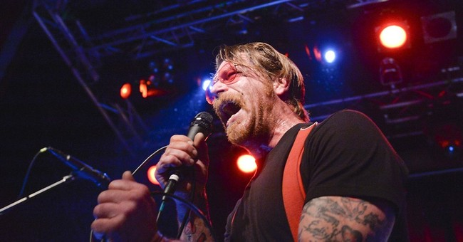 Leader of Eagles of Death Metal apologizes for comments