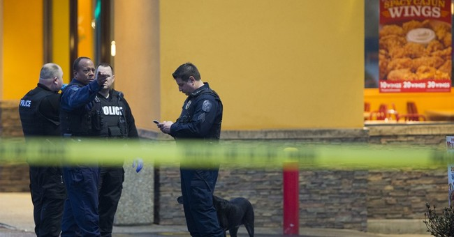 The Latest: Police: Gunman meant to die in station shootout