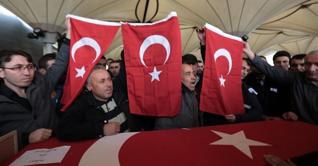 The Latest: Erdogan calls for wider definition of terrorist