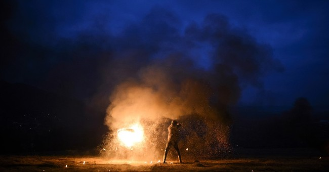 AP PHOTOS: Romanians burn tires to mark Orthodox Lent