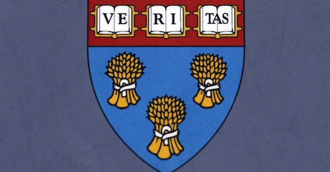 Harvard agrees to retire law school shield tied to slavery