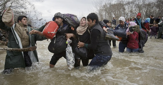 Migrants defy rain, rivers and Europe's border closures