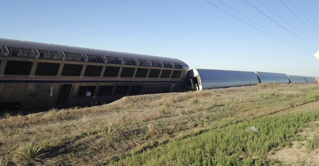 The Latest: Truck shifted track before Amtrak accident