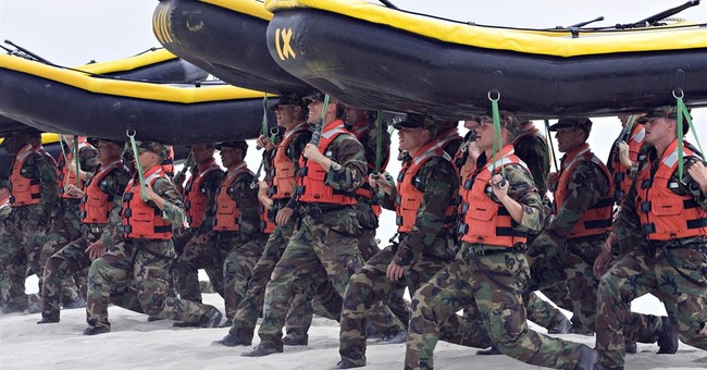 Navy says glitch caused improper pulling of SEALs' weapons