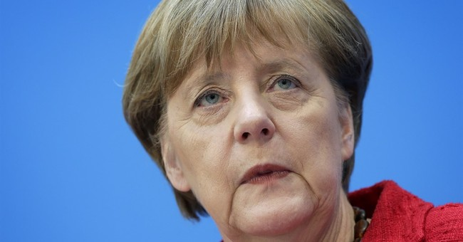 Merkel sticks to migrant course after German state elections