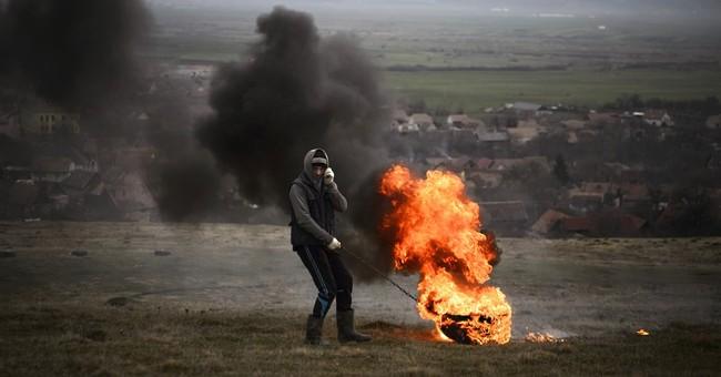 AP PHOTOS: Romanians burn tires to mark Orthodox Lent