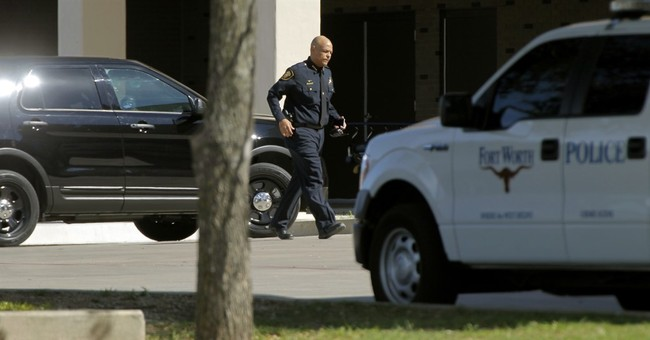 Suspect killed, officer wounded in shootout in Texas