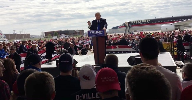Feds charge Ohio man who tried to rush Trump stage
