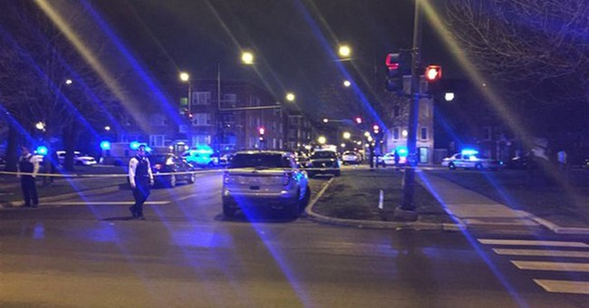 Latest: Chicago police say woman in custody after shootout