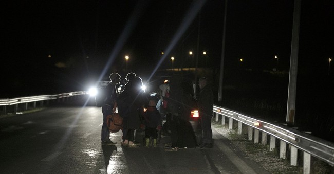 The Latest: Turkey says deal with EU has humanitarian factor