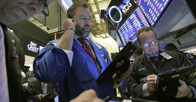 Asian markets mixed ahead of Fed decision, China meeting
