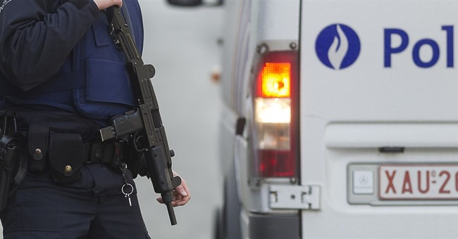 Police kill 1 man in Belgian raid linked to Paris attacks
