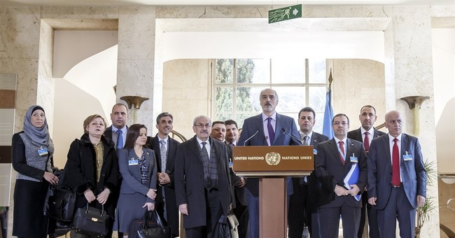 The Latest: Syrian opposition raises detainees at talks
