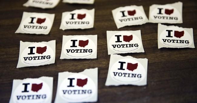 AP PHOTOS: Voters head to polls in delegate-rich primaries