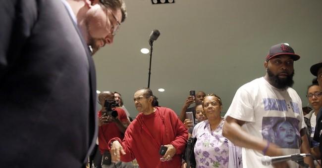 Ferguson City Council votes to accept DOJ reform deal