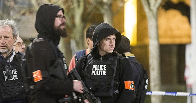 Hunt on for 2 in Belgian raid linked to Paris attacks