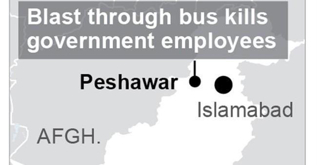 Bomb hits government bus in northwestern Pakistan, kills 15