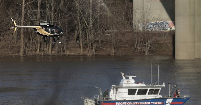 The Latest: Police try to ID who is in car in Ohio River