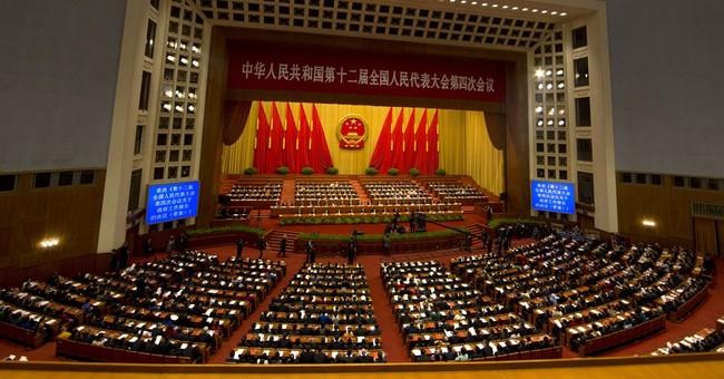 China's Li pledges more reform, says debt under control
