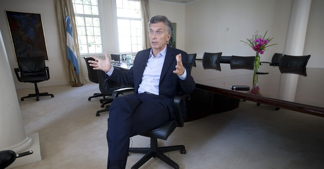 AP Interview: Argentine leader says outraged by corruption