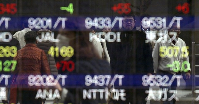Asian shares higher after Fed kept interest rates unchanged