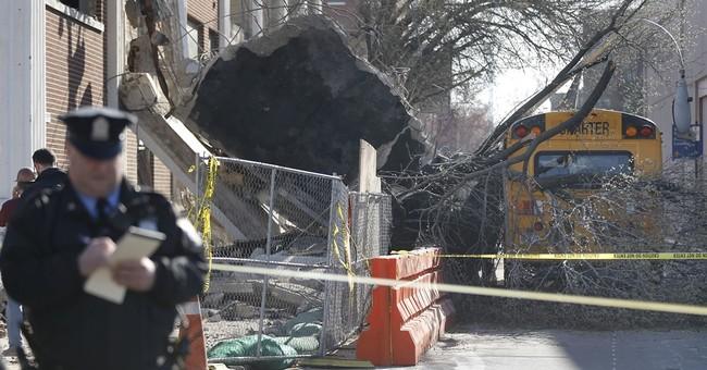 Part of Philadelphia building collapses against school bus