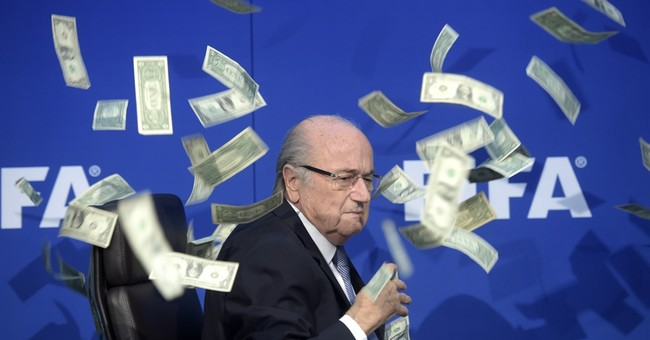 FIFA paid Blatter $3.76M in 2015, reports $122M loss