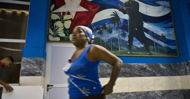 Cuba rebukes Obama's call for change but will nix dollar tax