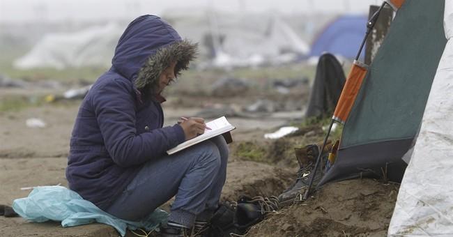 The Latest: Merkel urges migrants at Idomeni to leave camp