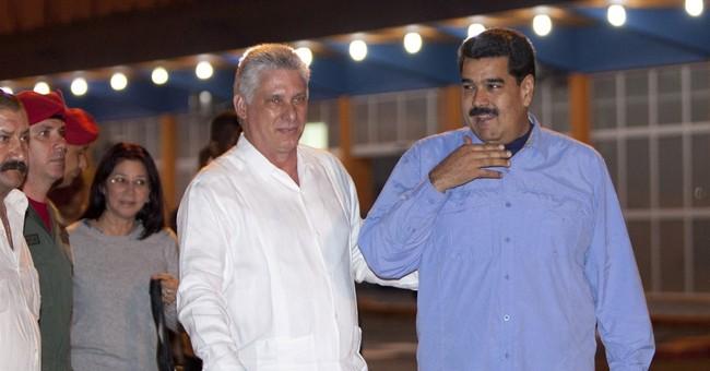 Venezuelan leader flies to Cuba ahead of Obama visit
