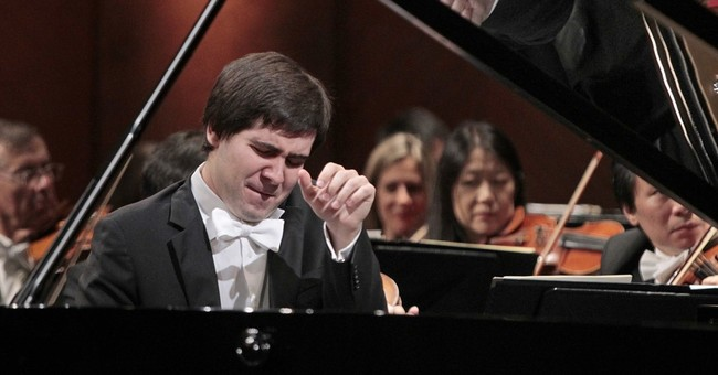 The Latest: Pianist mourns death of daughters