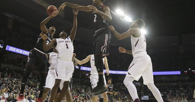 The Latest: Refs say Cincy dunk was still on fingertips