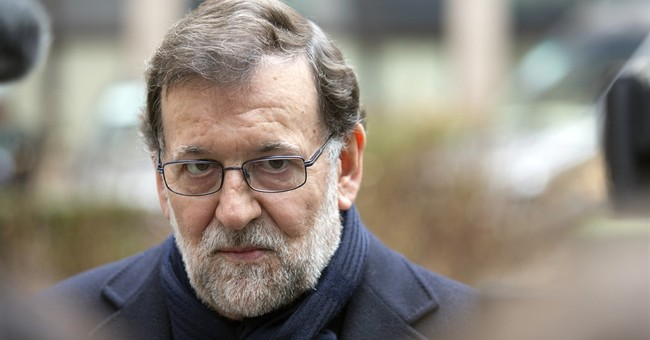 """Spain's acting PM won't give up on forming """"grand coalition"""""""