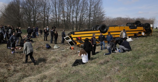 The Latest: 1 hospitalized, 26 released after bus crash