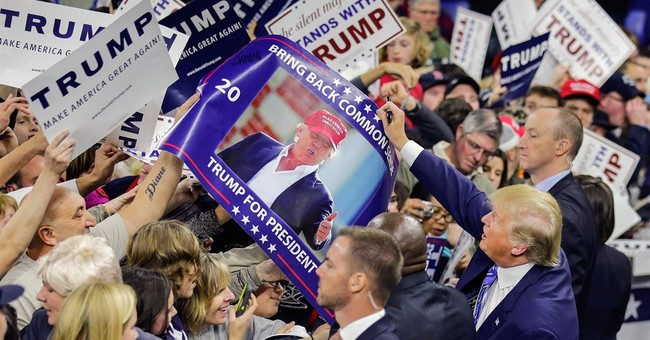 AP PHOTOS: Candidates start new year with intense campaign