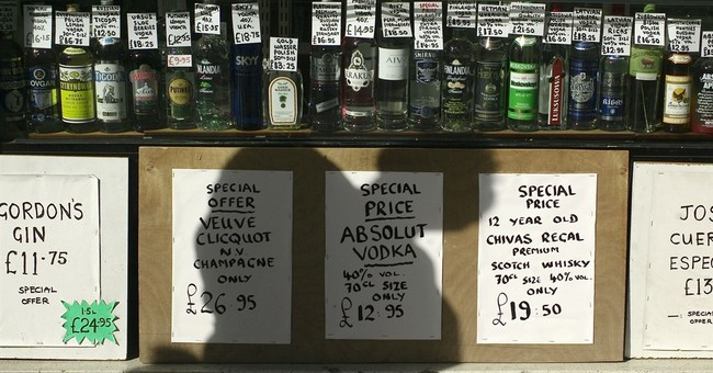 Q&A on UK's new drinking guidelines, alcohol link to cancer