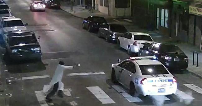 FBI treating shooting ambush of officer as terrorist attack
