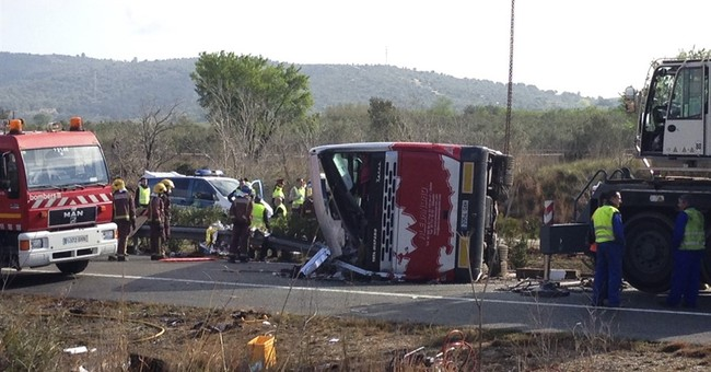 13 bus crash victims in Spain all women; 7 of them Italian
