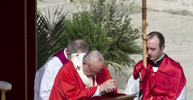 Pope in Palm Sunday homily decries indifference to refugees