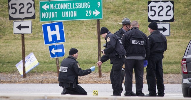 Police: Ex-trooper kills 2 in turnpike holdup, is shot dead
