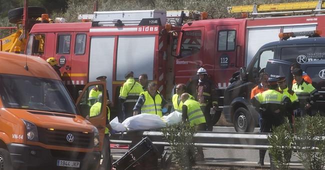 Spain bus crash kills 13 exchange students; 34 injured