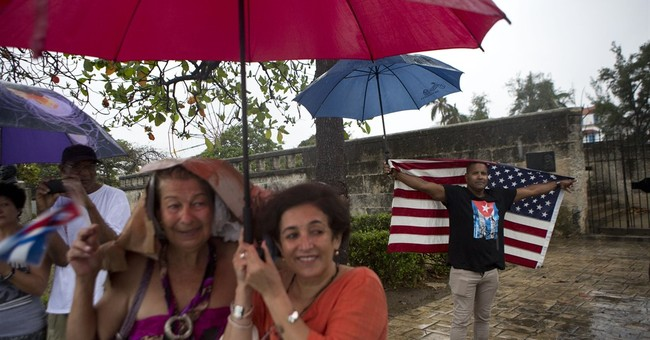 """Obama arrives in Cuba for what he calls a """"historic visit"""""""