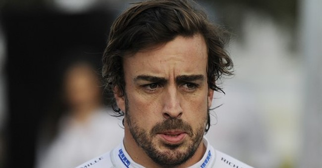 Alonso flips car after dramatic collision at Australian GP