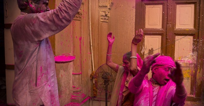Breaking taboo, Hindu widows celebrate festival of colors